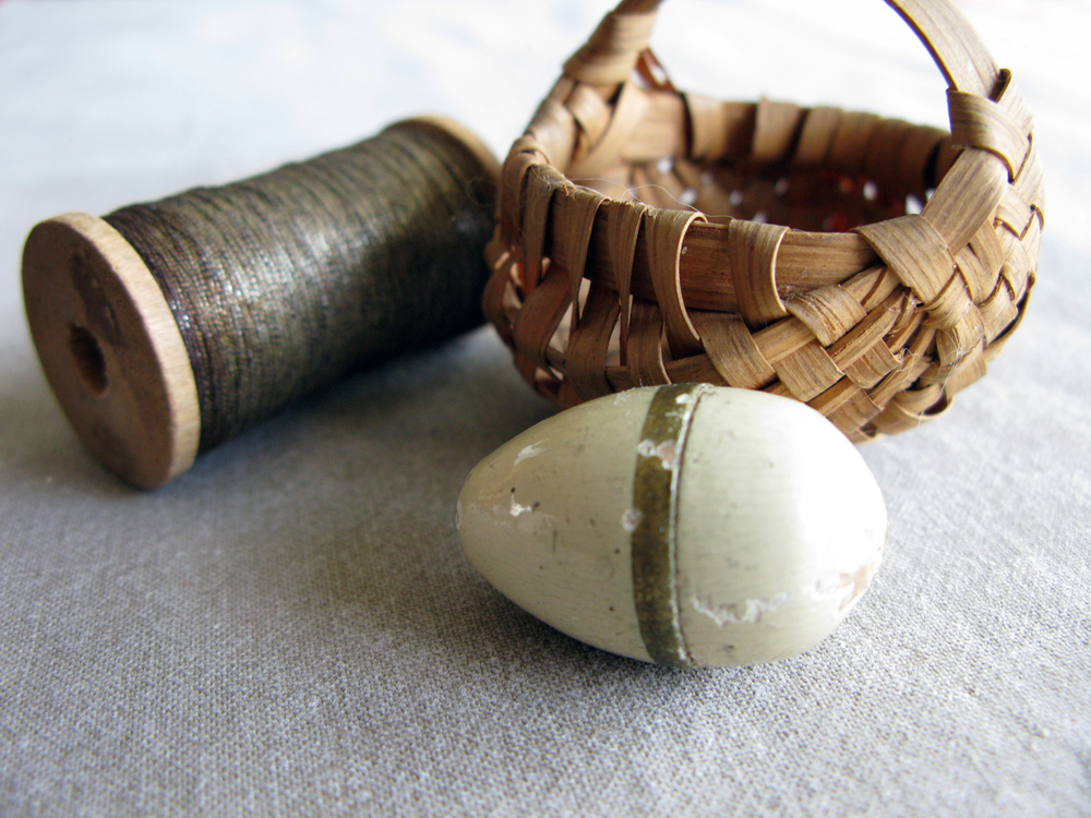 a tiny wooden easter egg
