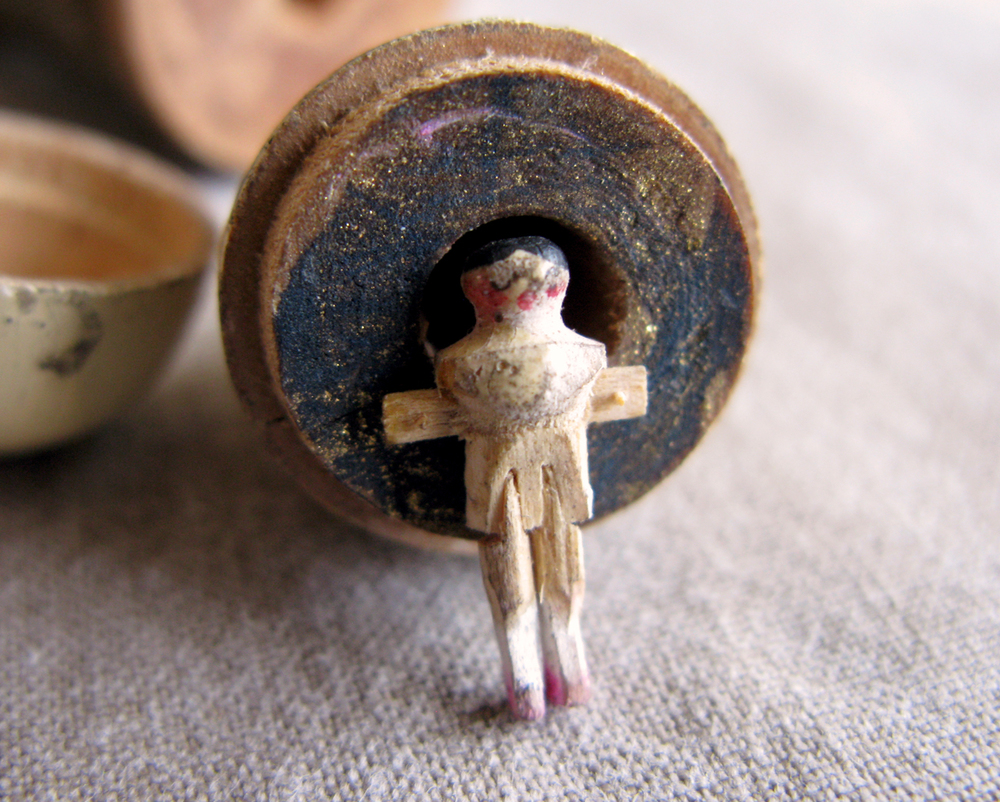 it's a tiny wooden doll