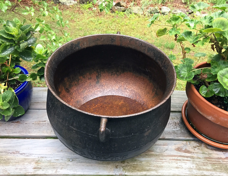 rusty iron cauldron