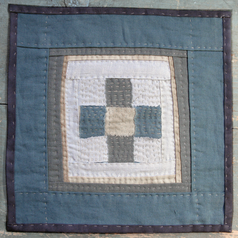 "LITTLE BLUE NINE-PATCH, 12"" X 12"" MADE FROM REPURPOSED TEXTILES."