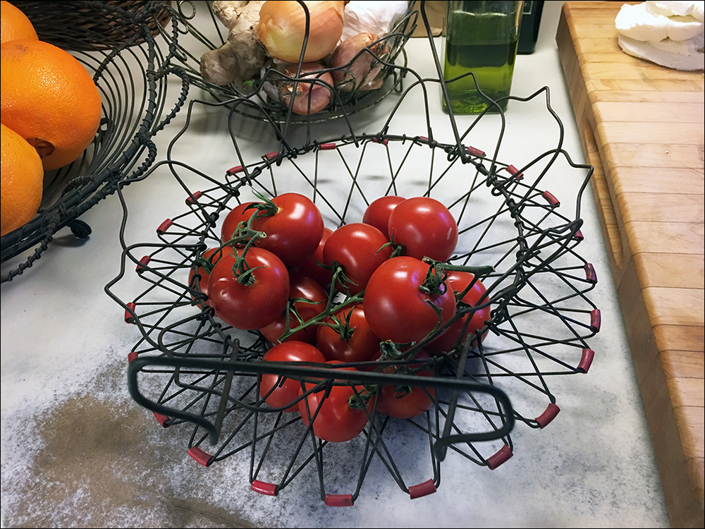tomatoes in wire baskt