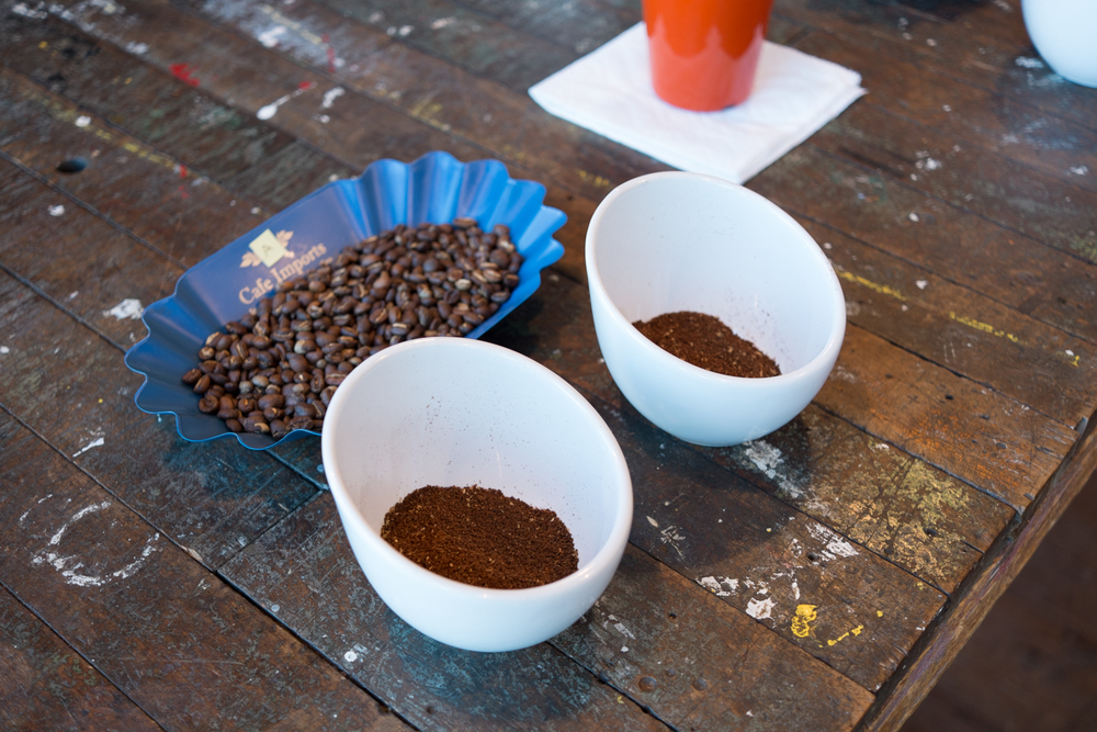 First the coffees to be cupped were ground, and placed out blindly.
