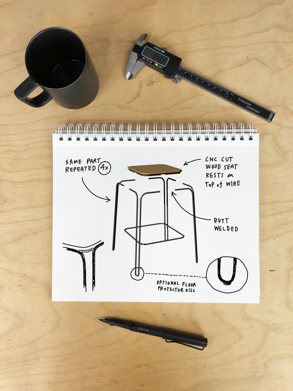 - While Stool Nº1 appears to have a continuous wire frame, it's actually constructed from 4 identical legs butt welded together. This creates manufacturing efficiency for the CNC wire bending process by only having to create a two types of parts—a few simple pieces come together to express the final design.