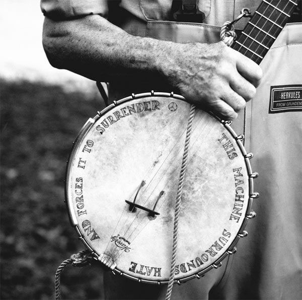Pete Seeger wearing a pair of Hercules Bibs at the shoreline of the Hudson River.