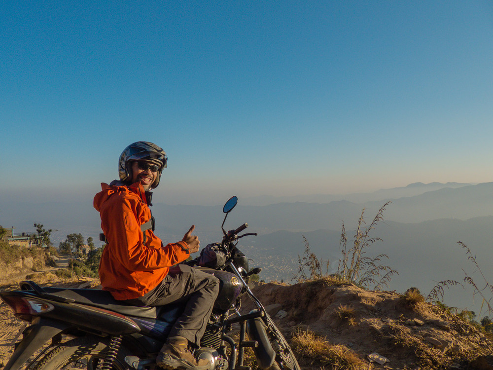 "Riding a motorcycle in the hills of Pokhara, Nepal - ""You don't need to be granted a iicense to live out your dream."""