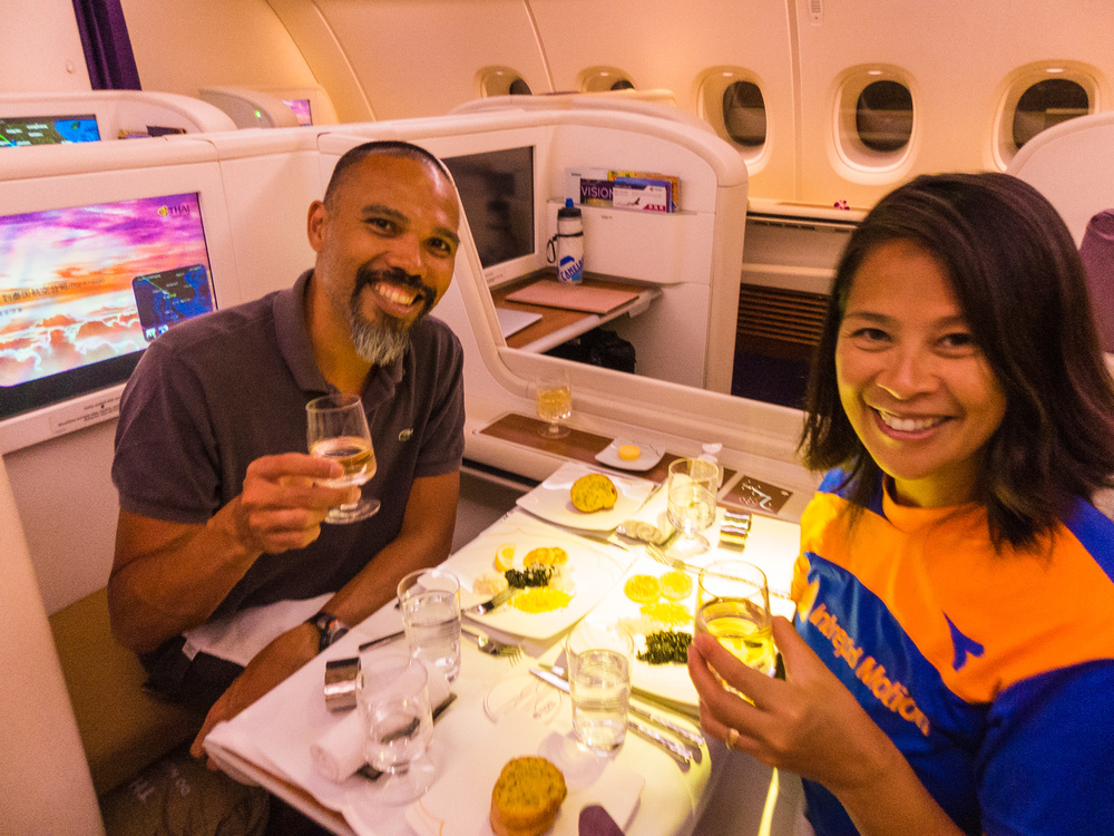 Enjoying a meal together on Royal Thai Airways Airbus A380 First Class to Paris for Josephine's birthday!