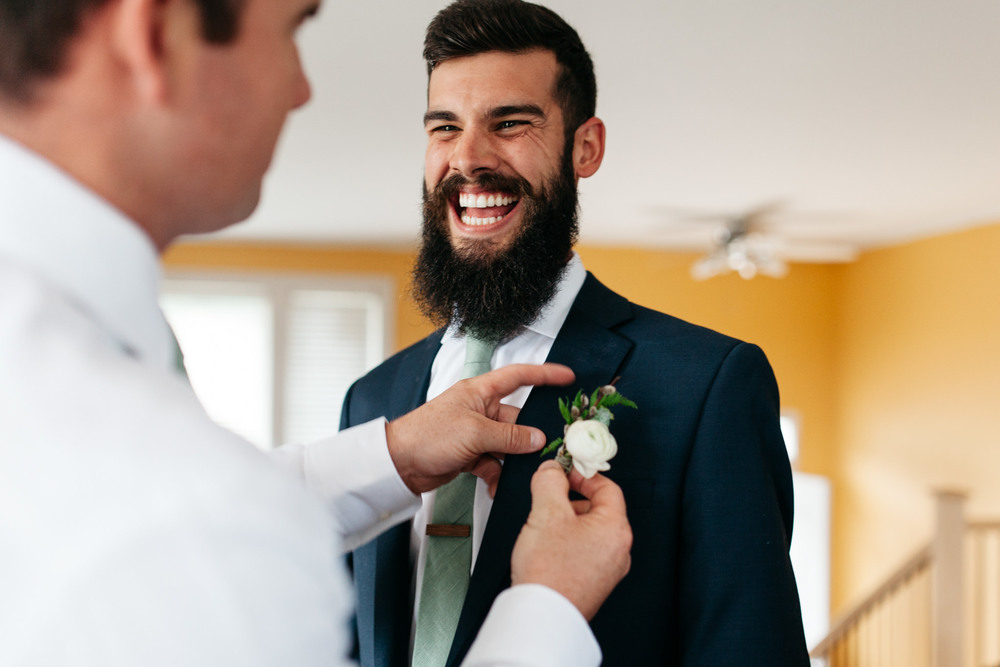 candid groom wedding day photo