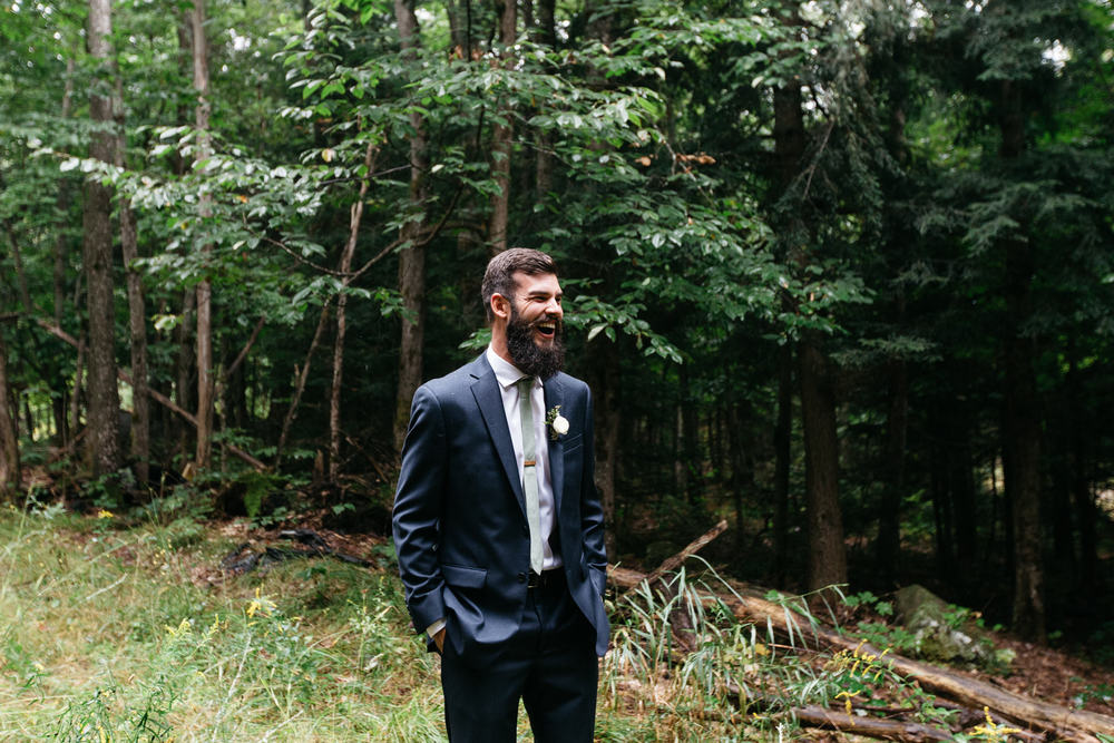 groom first look romantic forest wedding
