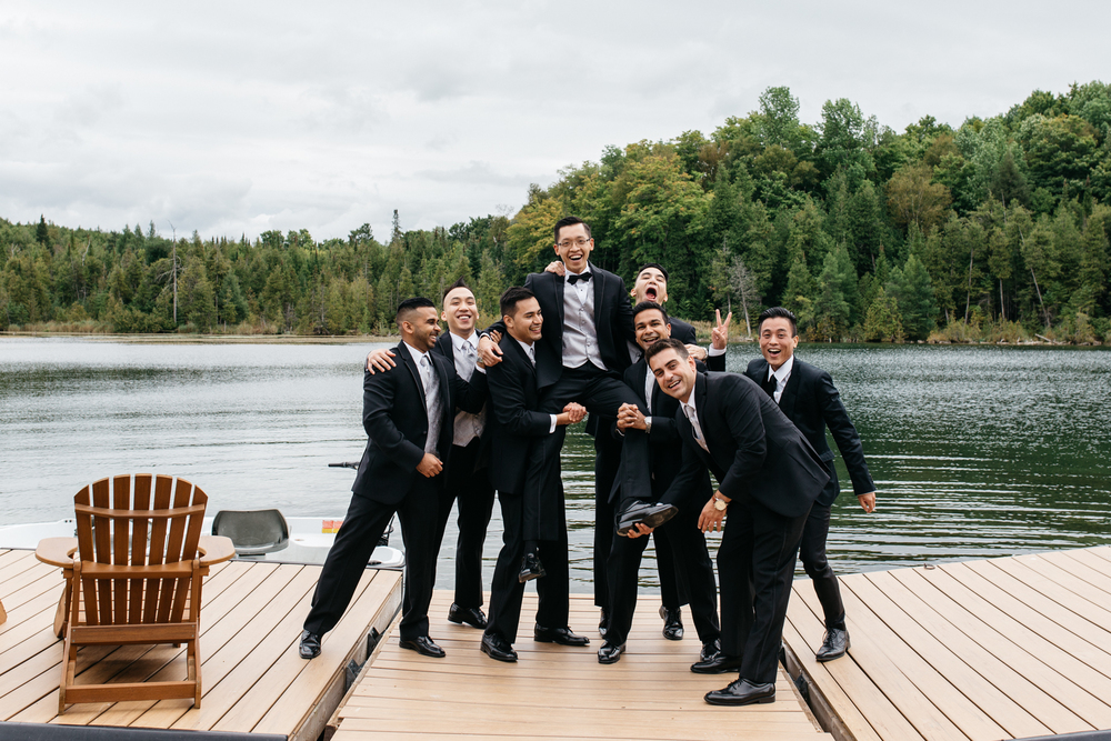 Fun Groomsmen Portrait Lakeside