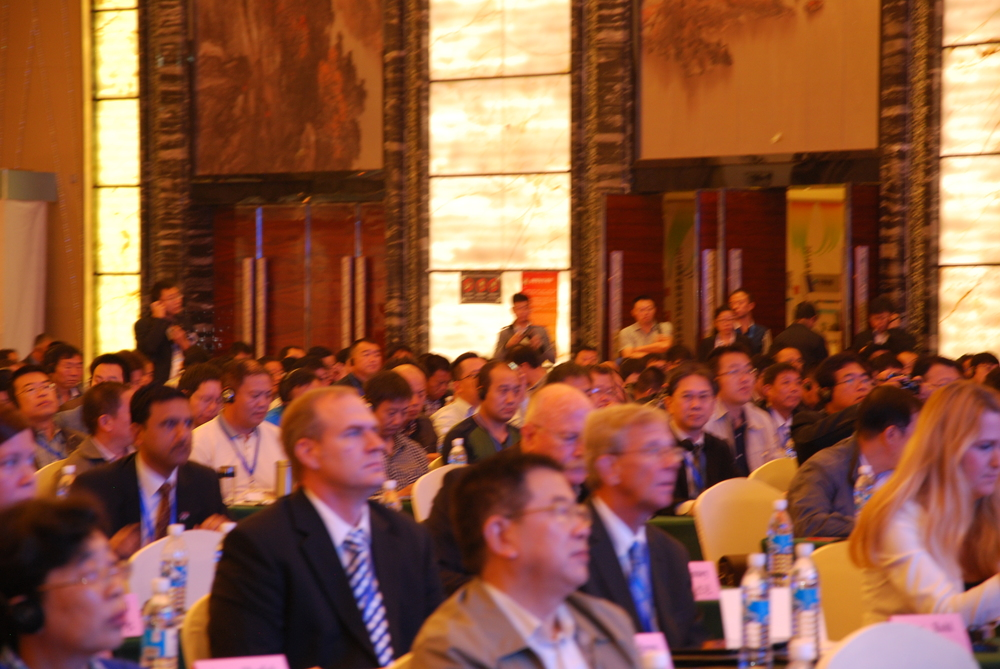 view from left of the stage in the main conference room, Day one. Delegates listen to presentations from domestic and international attendees.