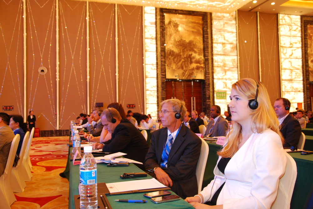 Asian Coal Ash Association coordinator Ms. Sonya Laing (right) and Dr. Tom Robl of the University of Kentucky (center) listen to simultaneous translation of presentations being delivered by Chinese experts.