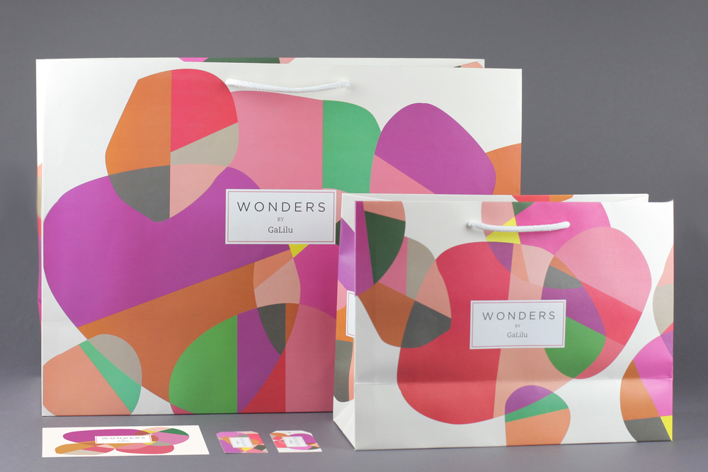 PRINTS FOR WONDERS CONCEPT STORE graphic design, packaging I had the pleasure of designing paper shopping bags in two sizes, clothing tags and postcards for this exceptional company - Wonders by GaliLu.