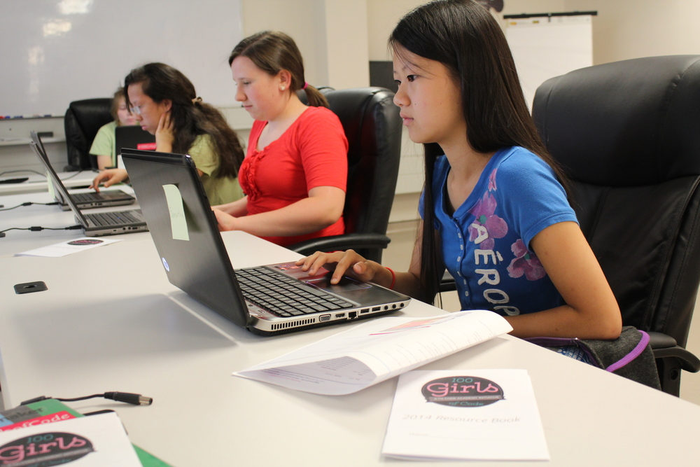 Girls focusing on their code in Cookeville