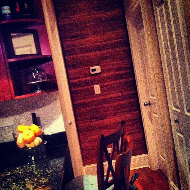 Home project: We used laminate flooring, nails and trim to create this wood wall look.