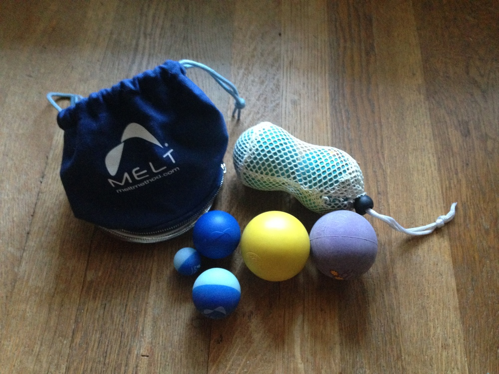 Here are some selections from my circular toolbox- the Melt Hand and Foot Kit, Yoga Tune Up® balls in a tote, and a lacrosse ball for comparison of density.