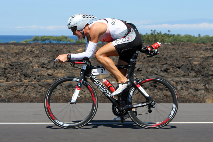This is an image from the 2007 Ironman World Championships, featuring  Denmark's Torbjørn Sindballe.  I obviously have no knowledge of ironman training, but I can see that he has fairly decent pelvic form, but has to go into serious spinal flexion because the handles are low (and add to that neck extension, i.e. nose and gaze up while spine orients down).  This means he can go super fast, but I just hope he has a good bodyworker for when he's done!