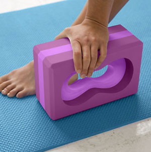 This is a block that allows gripping instead of placing the hand flat down on the floor or block.