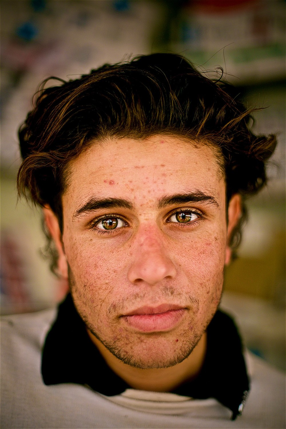 Majd says that the constant dust-storms and lack of proper structure for hygiene (lack of running water, for example), makes everyone sick for prolonged periods of time here. He especially loathes the acne that developed on his face after his arrival to the camp. (photo: Denis Bosnic)