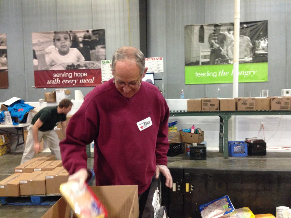 Fred Elswick sorts through donated food.