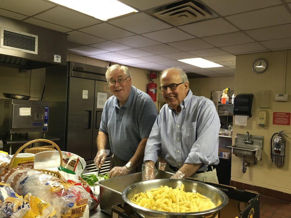 Walter Jones and Dick Allen helped make casseroles for the West End School