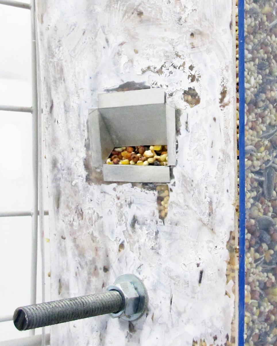 "Bird Feeder (detail), 2013 birdseed, wood, plastic, plexiglass, glass, cement, steel 60 "" x 12 "" x 9 """