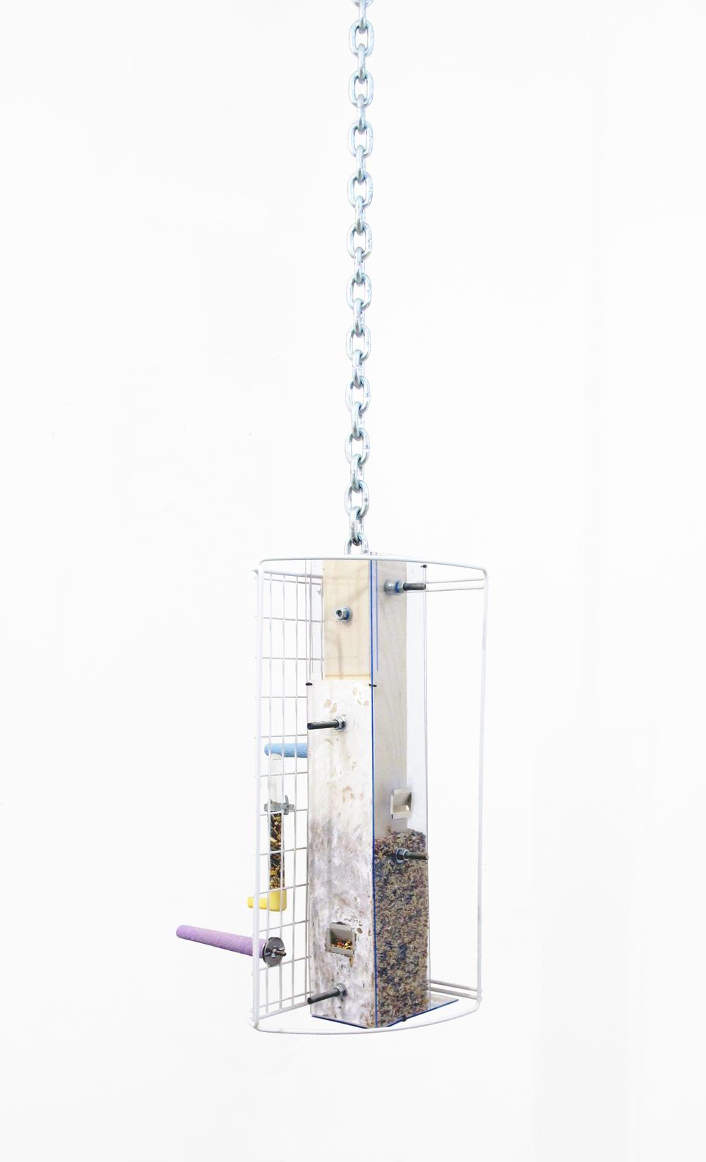 "Bird Feeder, 2013   birdseed, wood, plastic, plexiglass, glass, cement, steel   60 "" x 12 "" x 9 """