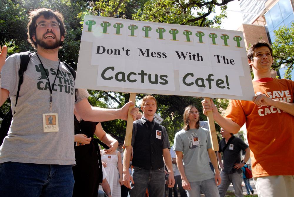 Zach Bidner (left) leads marchers, April 21, 2010. (4)