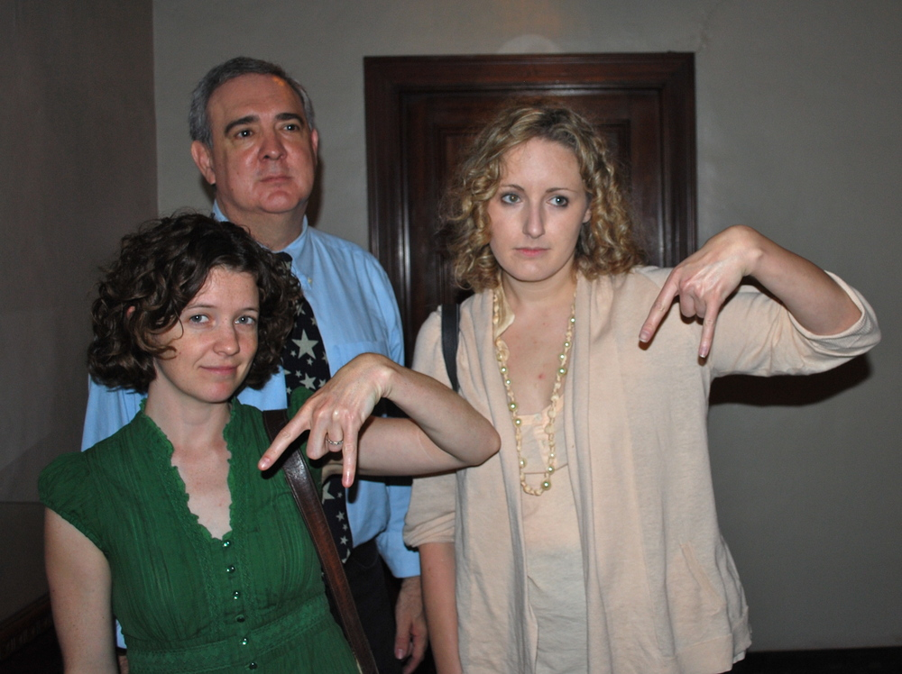 Horns down, as UT excludes Cactus advocates from a press conference, May 19, 2010. Hayley Gillespie (left), Prof. Tom Garza, and Tiffany Walker (14)