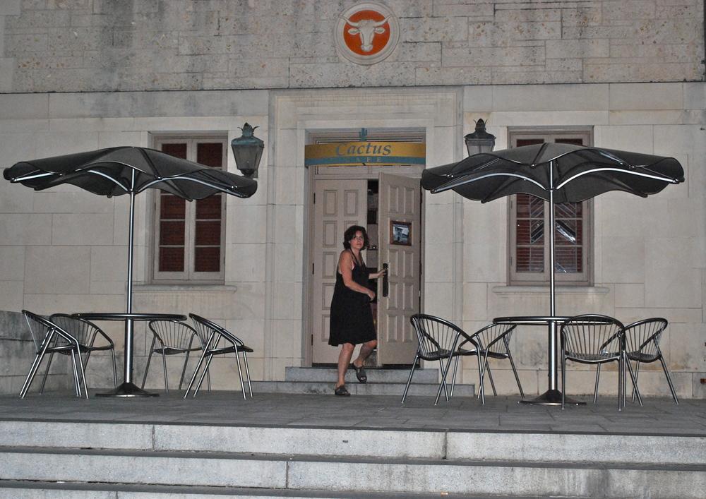 Bartender Susan Svedeman, at the Cactus' exterior door. (16)