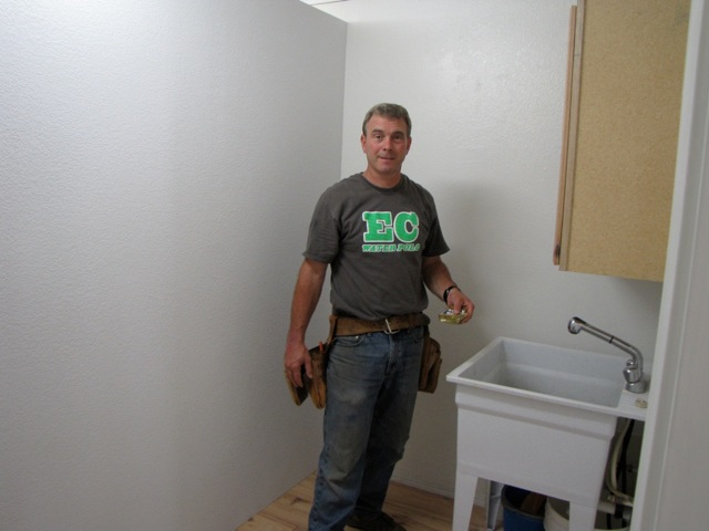Our Handyman, Joe Seither, at work in our new storage area...