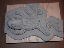 Carve out the body pattern details and add the realistic head.  Cut around the body shape in the bottom slab.