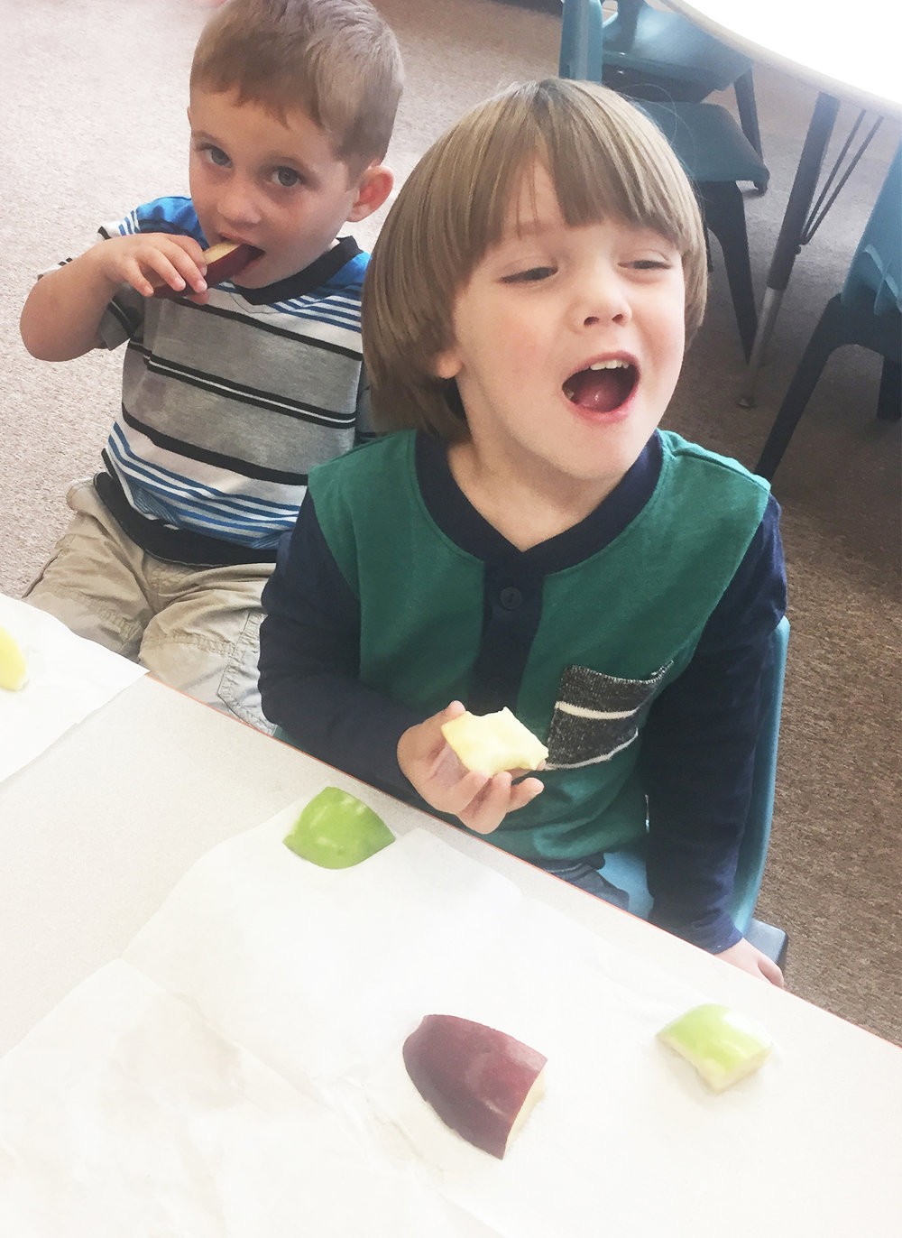 Bun and Caleb try Red Delicious apples.
