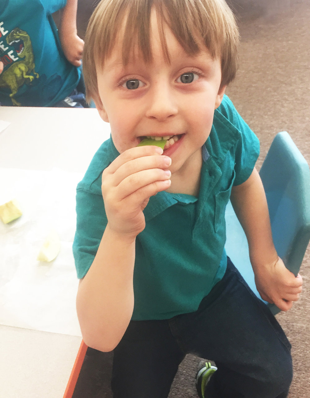 Jimmy tries a Granny Smith apple.