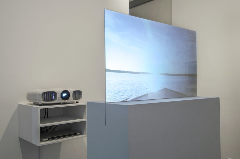 Installation Detail  (Shulamit Gallery, 2014)   Prodigal Sun,   2012  Single Channel HD Video Projection onto Glass in Pedestal, No Sound, TRT 2:20, Looping  69 x   30 x   12   Inches (Pedestal and Glass)