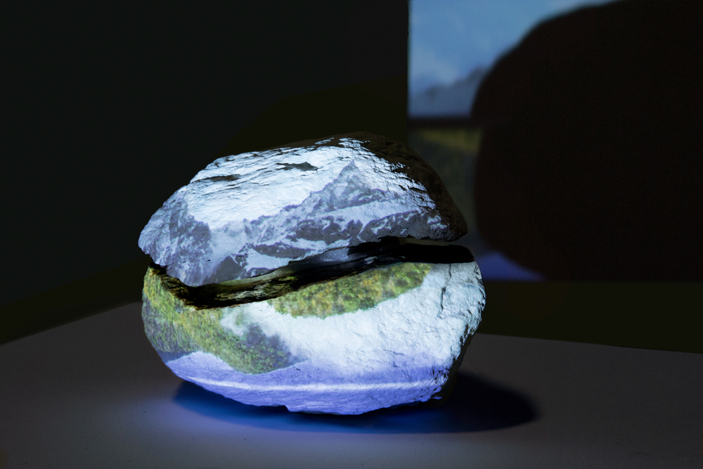 Installation View    Mountain is a Mountain,  Work In Progress Single channel HD video with sound projected onto rock, TRT approximately 10:00 minutes