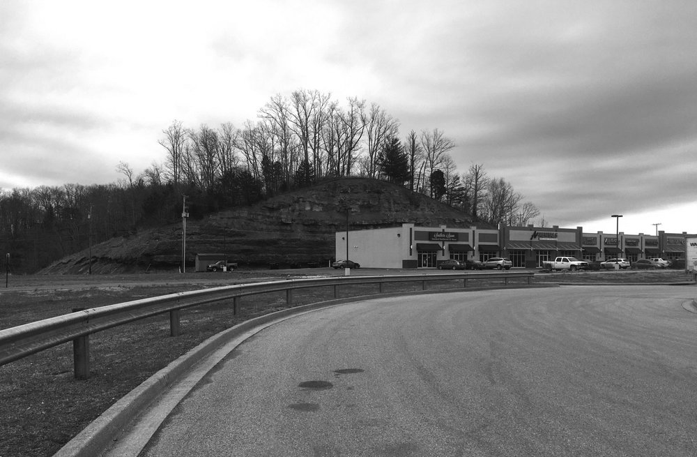 Former mining site redeveloped as a strip mall in Louisa, KY. (Research photograph, J. Becker)