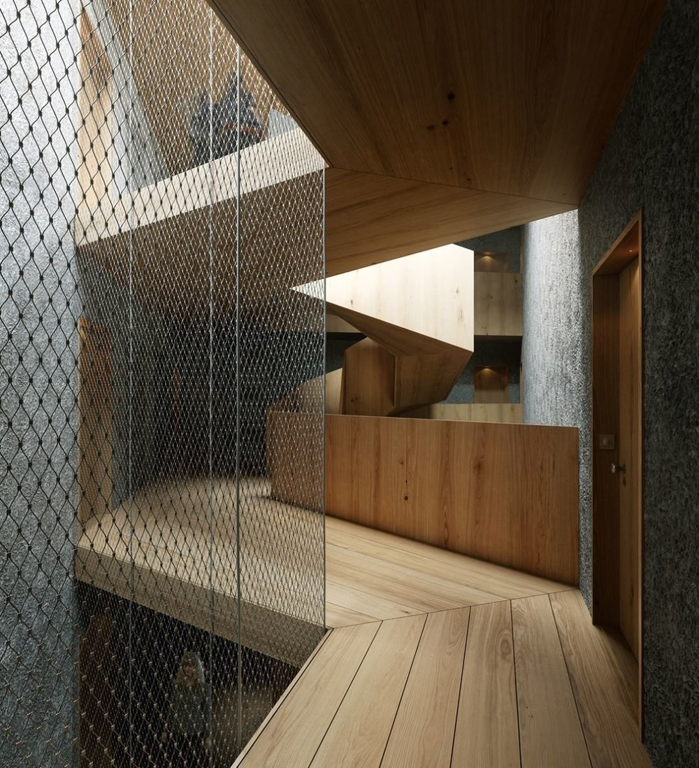 A wooden staircase contrasts with bare, concrete walls in Pilestredet P77. (Courtesy of Reiulf Ramstad Architects)
