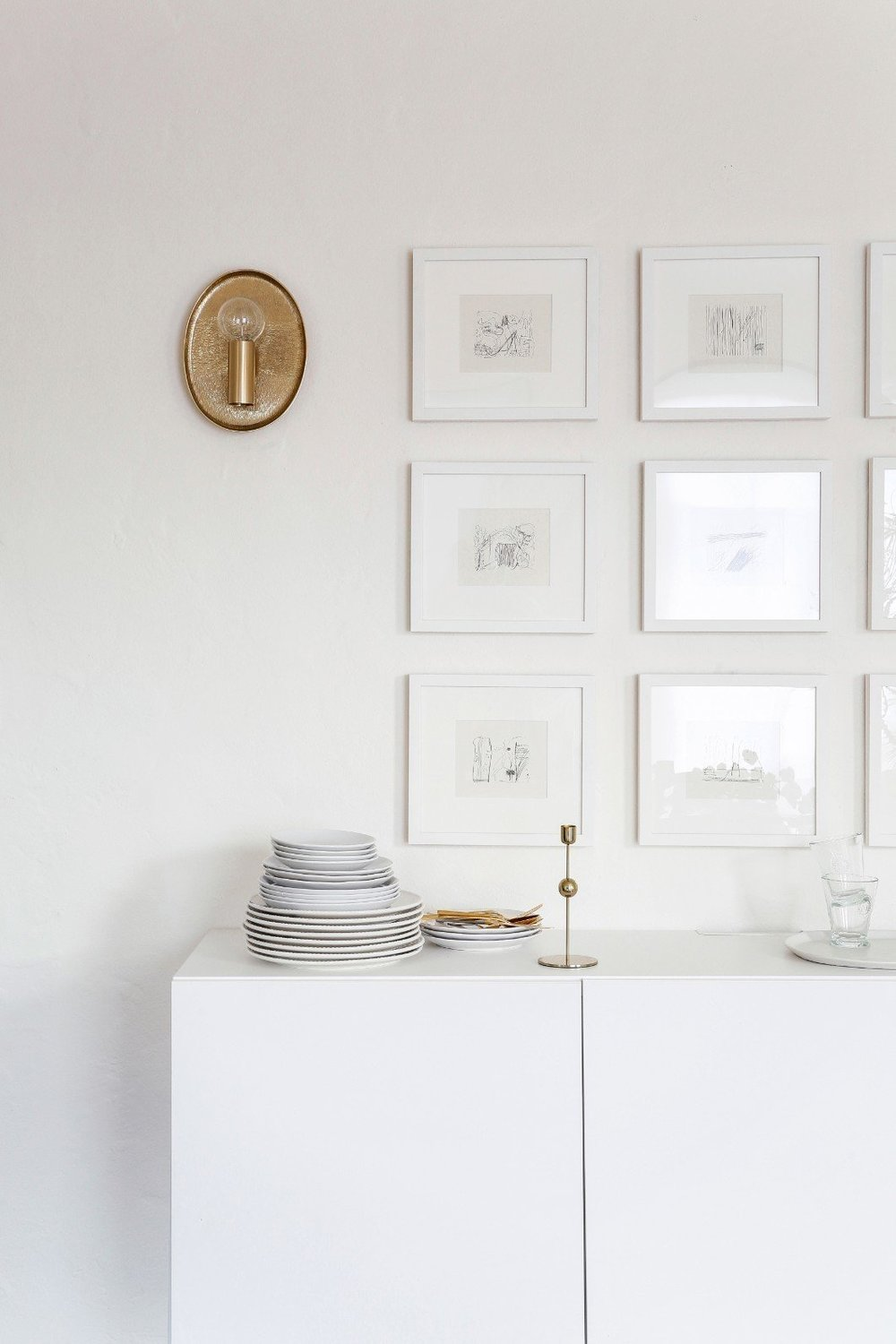 """My new favorite piece—well, pieces really—is my beautiful grid wall in my dining room,"" says Kate. ""I had the pages from a sketchbook I picked up in the dollar bin at an art book sale in San Francisco made into a custom gallery wall using Framebridge."" (Leslie Santarina)"