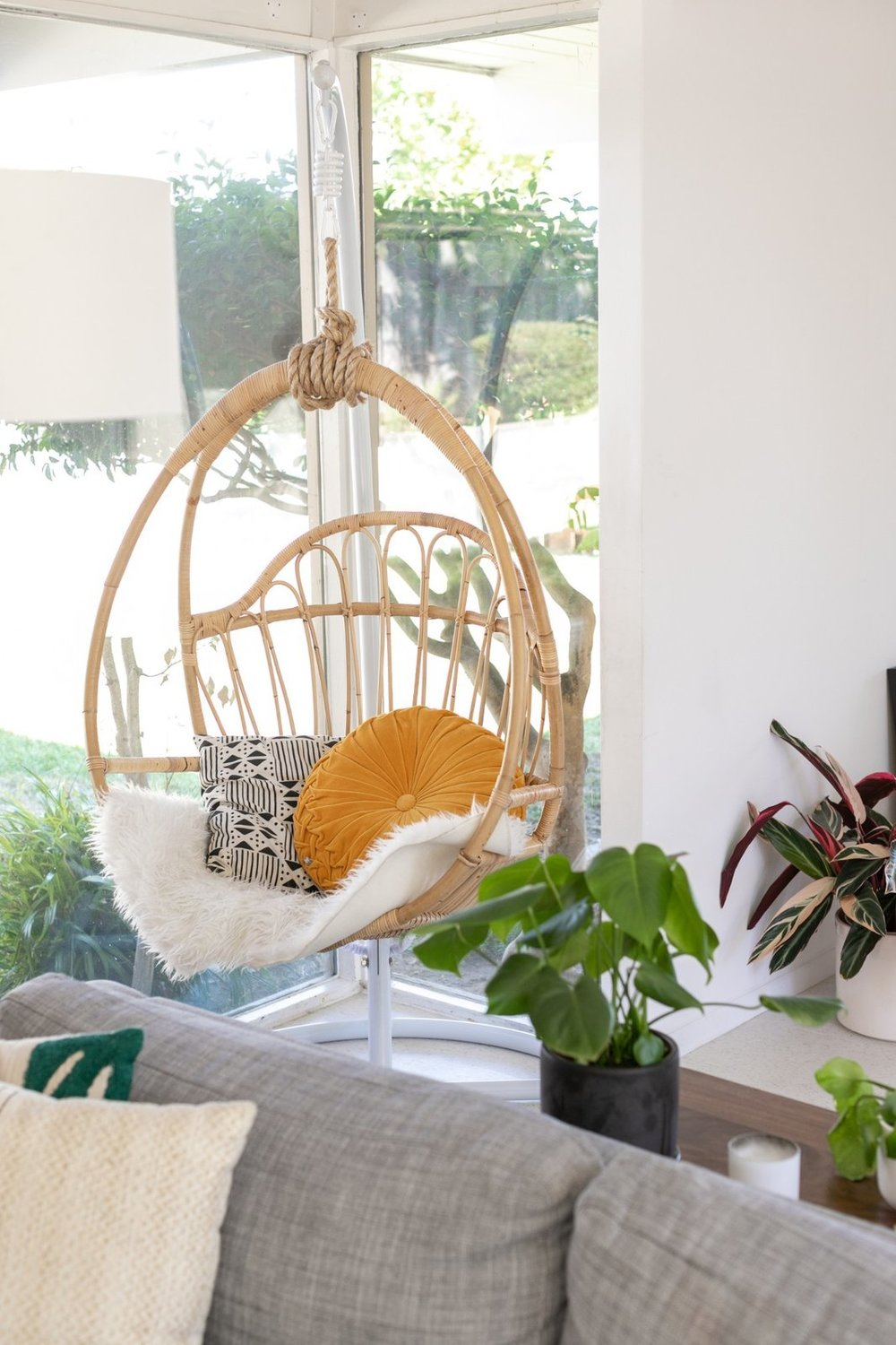 A hanging rattan chair is often used as a reading nook. (Sothear Nuon)