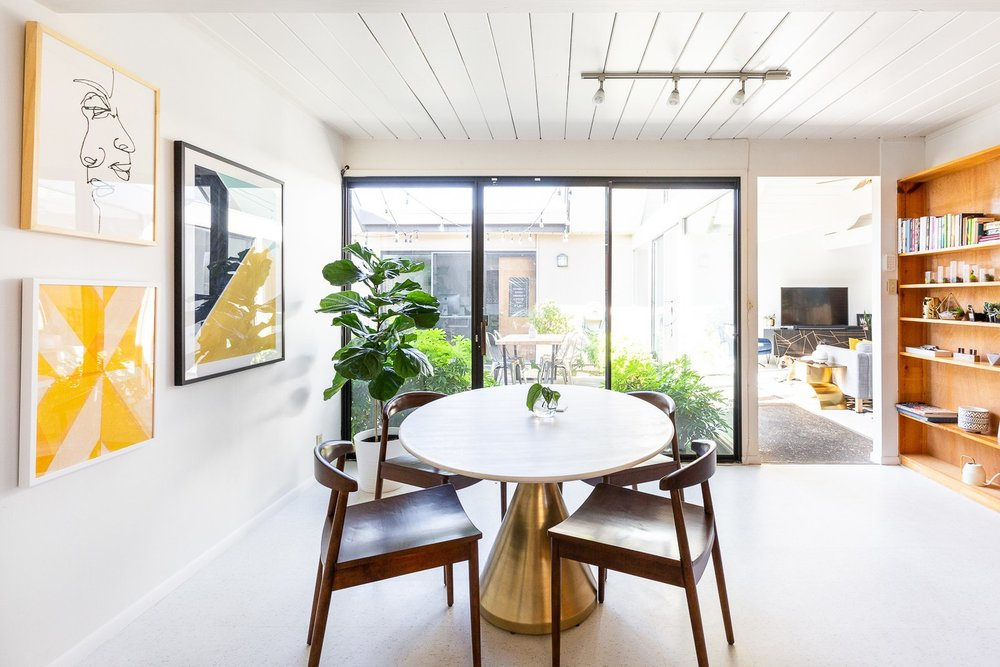 """""""A space in my house that I love is our bougie breakfast nook with the fancy marble table and brass pedestal bottom,"""" says Encarnacion. (Gillian Walsworth)"""