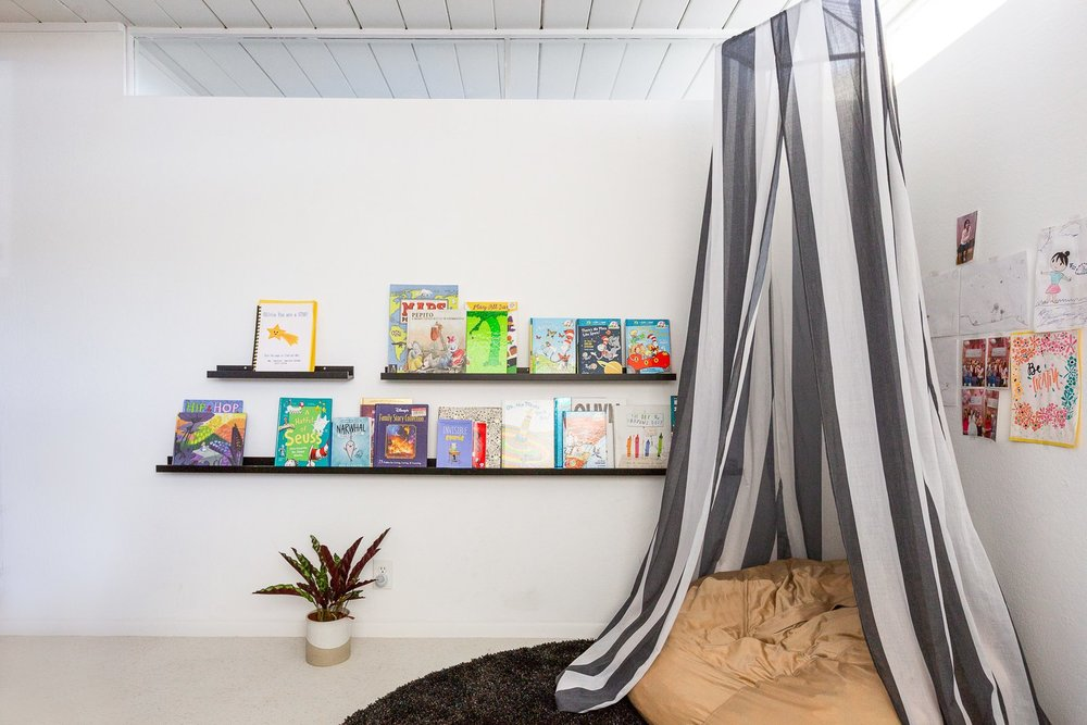 In 8-year-old Olivia's room, minimalist bookshelves and a comfy hideaway make for the perfect retreat. (Gillian Walsworth)