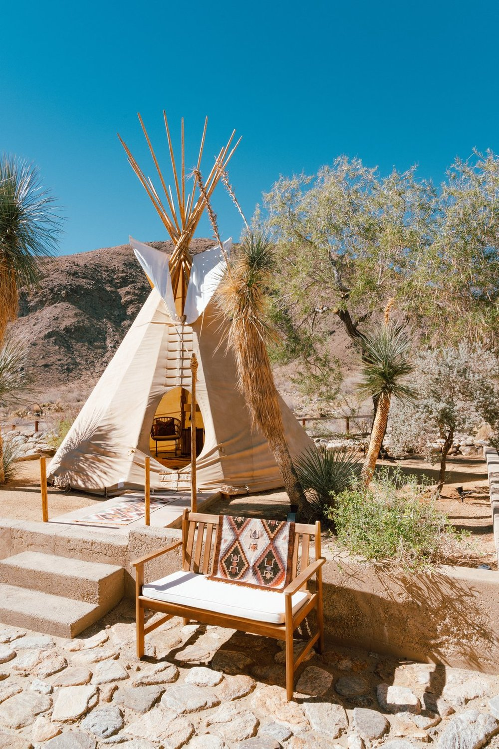 """""""The teepee is 26' canvas with pine lodge poles. It's simple in construction as it was originally intended to be a nomadic dwelling. It is extremely reliable in the high desert winds and even great in the rain. We have a small fire pit in there to keep it toasty on cool winter evenings. It's one my favorite places on the property."""" (Tim Melideo)"""