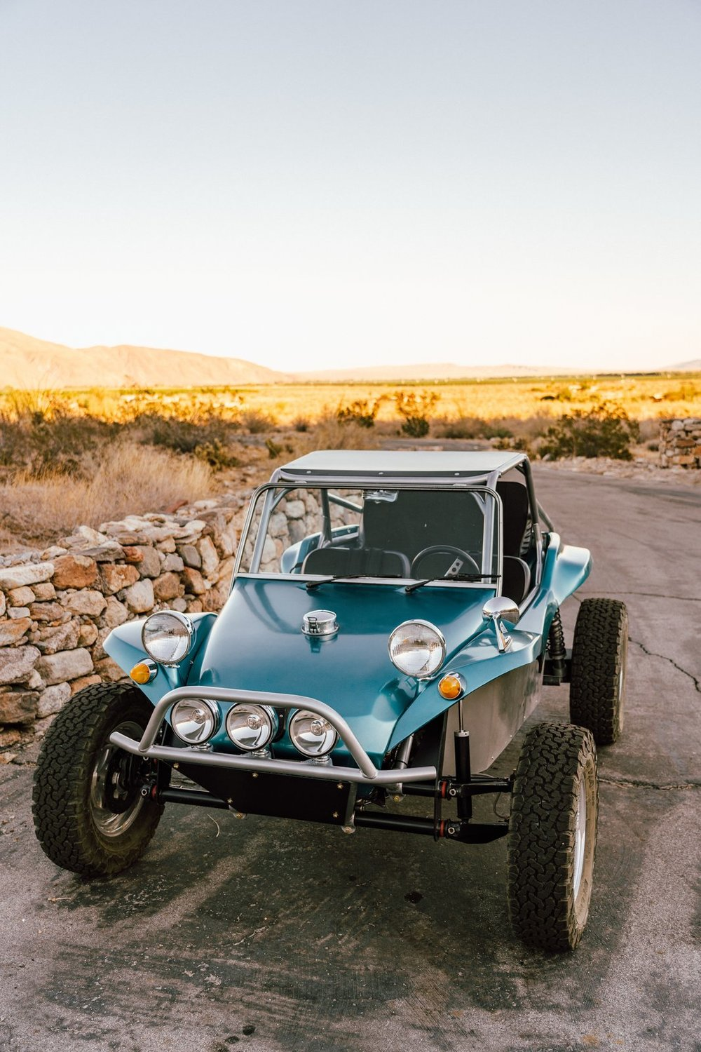 """""""The buggy is a 1972 VW Meyers Manx dune buggy. We bought it last year and had quite a bit of work done to it so it can handle the rugged desert terrain with ease. We added a new frame, new suspension, new tires, new wiring, and a roll cage. The engine and the body are the only original elements."""" (Tim Melideo)"""
