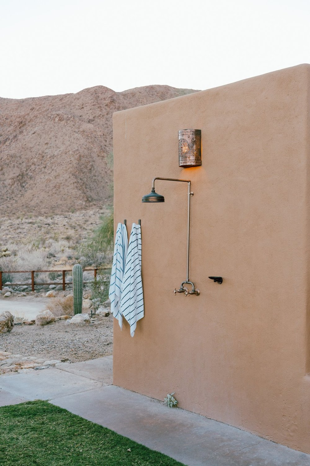 An outdoor shower welcomes Young home after a day out in the dunes. (Tim Melideo)