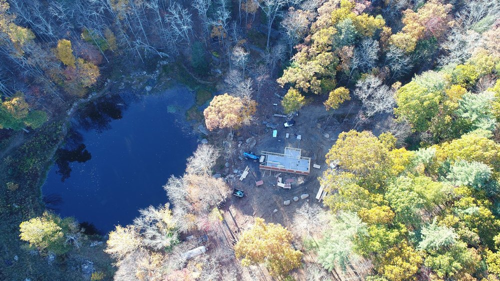 A view of the property from above shows the cabin in progress. (Bjorg Magnea)