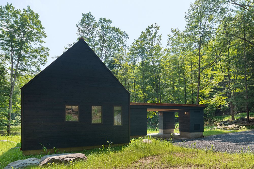 The back of the home and gable ends are covered in blackened cedar. (Bjorg Magnea)