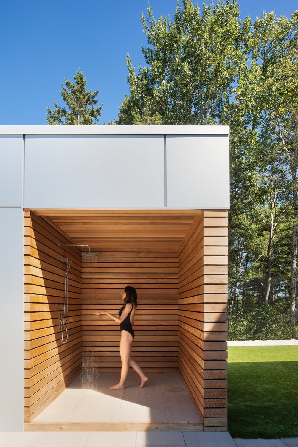 An outdoor shower offers a zen-like sanctuary to wash off the day. (Ema Peter Photography)
