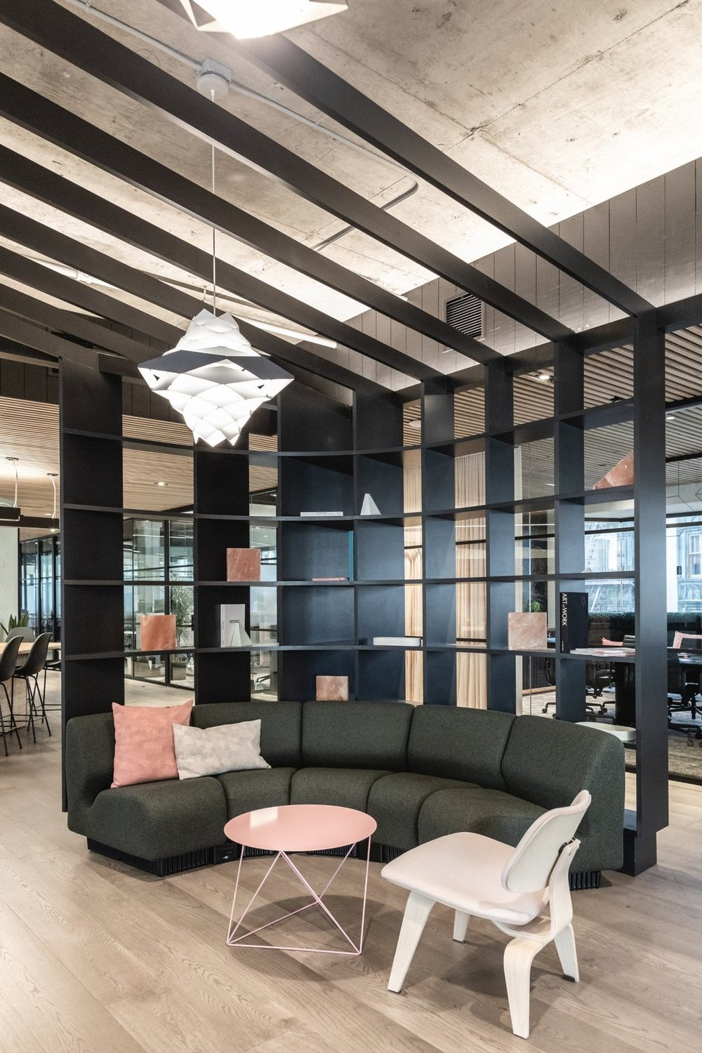 A literal canopy wraps around the the lounge serving as a shelf and barrier between the conference and work areas. (Sothear Nuon)
