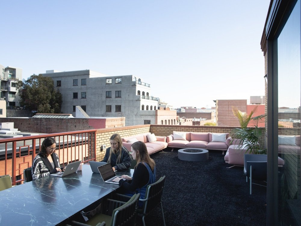 The 1,500-square-foot terrace serves as a casual lounge space, cafe-style seating, marble tables, and ergonomic, heated seating by Galanter & Jones. The awning, made of recycled sails in collaboration with Mafia Bags founder Marcos Mafia, protects from the elements. (Sothear Nuon)