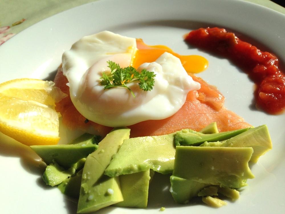 Poached egg on smoked salmon with avocado and salsa